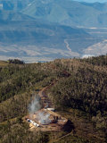 Smoke Rises from a Drilling Rig on the Roan Plateau Photographic Print by Peter M. Fredin