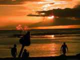 Waikiki Beach-Goers Watch as the Sun Sets Slowly Photographic Print