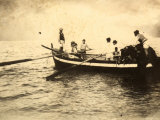 Fisherman Embarking from the Seashore on Their Boat Photographic Print