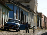 A Cuban Man Gets out of His Car with His Child Photographic Print by Javier Galeano