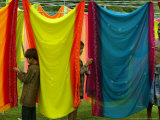 A Washerman with His Children Hang Clothes Photographic Print by Rajesh Kumar Singh
