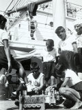 On the Deck of a Ship, a Boy Acts as a Shoeshine Around Him, Other Boys in Sailor Clothes Photographic Print