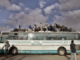 Palestinians Sit on Top of a Bus Photographic Print