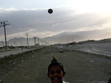 Afghan Boys Play with a Ball in Kabul, Afghanistan, Friday, July 7, 2006 Photographic Print by Rodrigo Abd