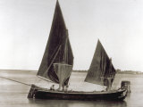 Sailboat Used for Fishing Moored Along the Venetian Lagoon Photographic Print