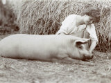 Young Peasant-Woman Kneeling Down Beside a Small Pig Photographic Print
