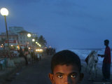 A Sri Lankan Boy Looks as He Sells Prawns at the Sea Front, in Colombo, Sri Lanka, June 30, 2006 Photographic Print by Manish Swarup