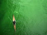 A Lone Kayaker Travels Down the Chicago River after It was Painted Green Photographic Print
