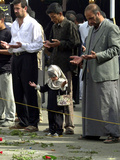 Iraqis, Inluding a Little Girl, Pause to Pray Photographic Print
