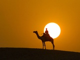 An Egyptian Policeman Looks at the Setting Sun Photographic Print