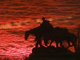 A Vivid Late-Autumn Sunset Silhouettes the Statue Known as Pioneer Mother at Penn Valley Park Photographic Print