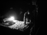 An Afghan Vendor Sells Eggs by Lantern Light Photographic Print