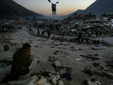 A Homeless Pakistani Earthquake Survivor Sits on the Roadside Photographic Print