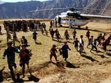 Local Children Run from a Helicopter Photographic Print