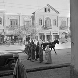 Men and Women, Wearing the Traditional Burqa, Walk Along a Street in Kabul Photographic Print