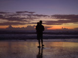 A Father and Son Enjoy Sunset by a Beach Photographic Print