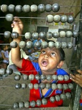 Boy, 3, Counts on an Abacus at a School in Allahabad Photographic Print