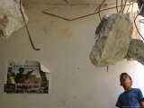 A Palestinian Boy Looks Inside the Damaged House of Militants Moatasm Sharaidi and Elias Ashkar Photographic Print