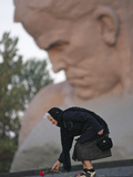 A Woman Lays Flowers on the Unknown Soldier Monument Near the Brest Fortress Photographic Print