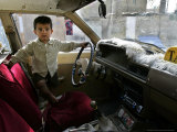 An Iraqi Child Stands in His Father's Taxi Photographic Print