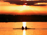 A Beautiful Sunrise Over the Sydney International Regatta Center Sillouhettes a Boat Photographic Print