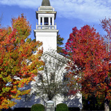 Bright Colors Adorn the Trees Near a Church Photographic Print