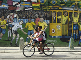 Two Children Ride Their Bicycle Pass a Mural Photographic Print