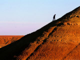 A Tourist Climbs to the Top of Ait Ben Haddou Fortress Near Ourzazatte Photographic Print