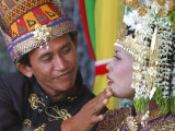 An Acehnese Bridegroom Cleans Face of His Bride During a Mass Wedding for Tsunami Victims Photographic Print
