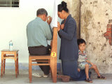 A Vietnamese Woman Sits with a Priest at a Makeshift Confessional Along Side of the La Vang Church Photographic Print