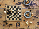 A Chess Board and Unemptied Ashtrays Photographic Print