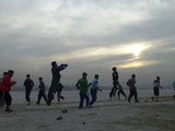 Afghan Youths Warm up Themselves Before a Soccer Match Photographic Print