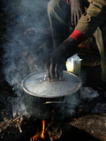 A Man, 24, from Ghana, Prepares His Meal Photographic Print