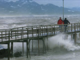 Pedestrians Walk on a Pier During Heavy Storms on Lake Chiemsee Photographic Print