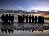 Tourists Enjoy Sunset on a Beach Photographic Print