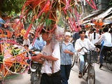 Vietnamese Vendors Crowd a Street Selling Colored Lanterns on a Street in Downtown Hanoi Photographic Print