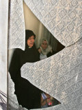 A Family are Seen Through the Shattered Window of Their House Photographic Print