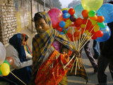 A Woman Sells Balloons During a Religious Procession Photographic Print