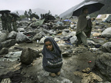 A Pakistani Earthquake Survivor Shivers Photographic Print