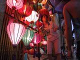 A Lantern Vendor Displays Her Silk Lanterns to a Tourist During the Full Moon Festival Photographic Print