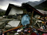 A Pakistani Earthquake Survivor Takes Shelter from the Rain Photographic Print