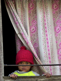 A Nepali Child Looks out from a Window at Pro-Democracy Activists Photographic Print