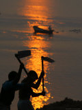 Indian Laborers Work on the Banks of the River Ganges at Sunset Photographic Print