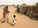 An Elderly Woman and Child Walk Past an African Union Photographic Print