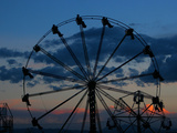 Bolivian Indigenous People Have Fun on a Ferris Wheel at Dawn at a Rural Fair Photographic Print