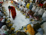 A Crowd of Women Who Pray in a Nearby Temple Six Hours a Day in Exchange for Meals and Money Photographic Print