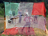 A Soccer Ball Slips Through an Opening of a Makeshift Goal Photographie