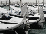A Layer of Fresh Snow Coats Gondolas Moored in Venice, Italy Photographic Print