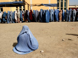 Afghan Widows Waits for Food During a Distribution Program by Care Photographic Print