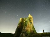 Stars in the Sky are Seen Over a Remains of Medieval Fortress Photographic Print